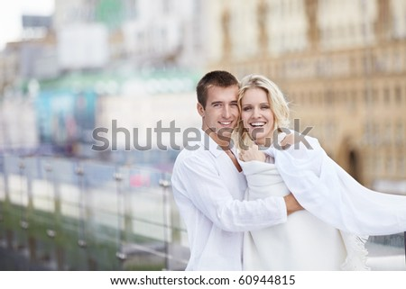 The happy couple in white on the roof - stock photo