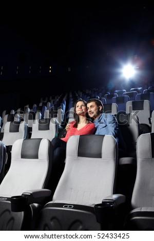 The happy enamoured couple looks cinema - stock photo