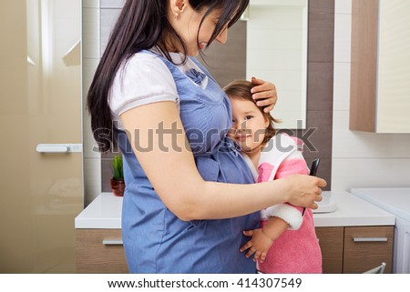 The happy family mother and baby daughter. - stock photo