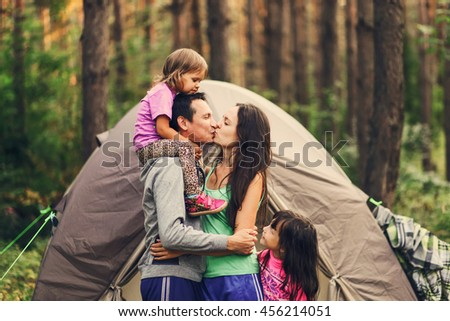 The Happy family together at a campsite. - stock photo