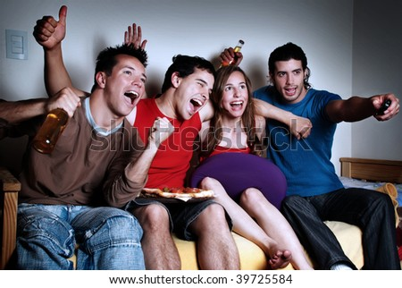 The happy fans  watching TV