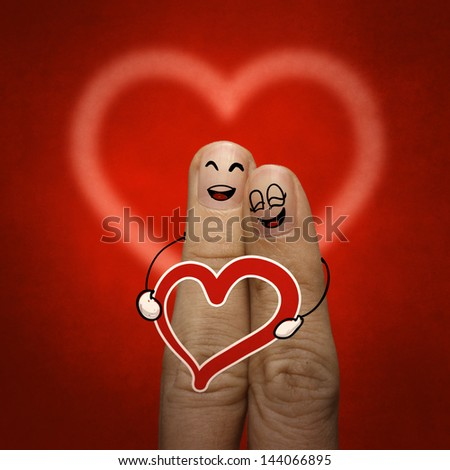 the happy finger couple in love with painted smiley and hold heart as vintage style - stock photo