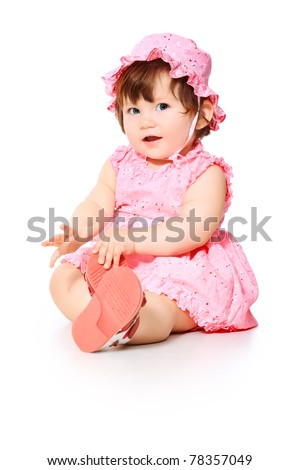 The happy girl in a pink dress, isolated on a white background - stock photo
