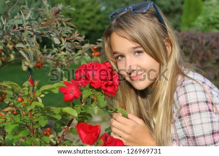 The happy girl with red flower - stock photo