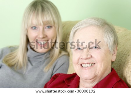 The happy mother and daughter together - stock photo