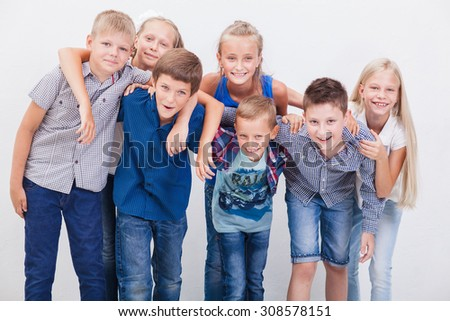 The  happy smiling teenagers on white background. - stock photo