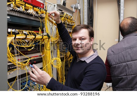 The happy technician posing at server room