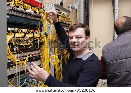 The happy technician posing at server room - stock photo