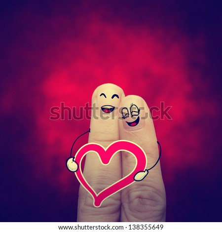the happy vintage  finger couple in love with painted smiley classic - stock photo