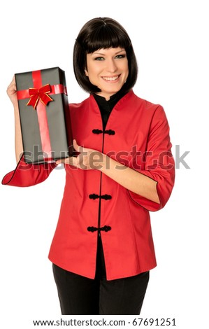 The happy woman dressed in Chinese style has bought a gift at a discount - stock photo