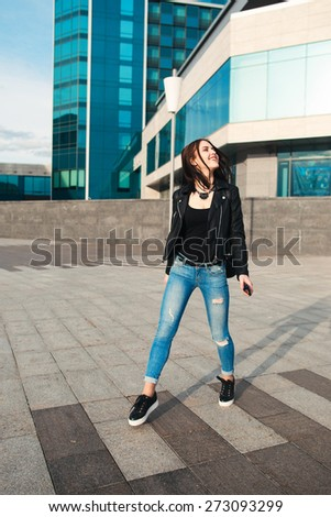 the happy woman jumps on the street - stock photo