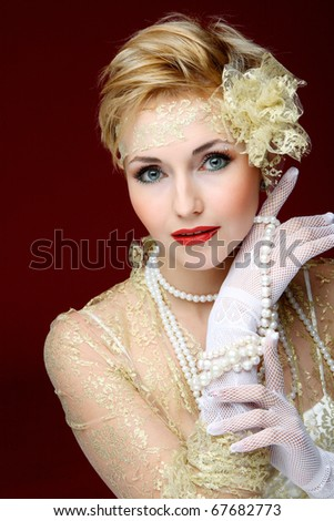The happy young girl in an ornament from pearls - stock photo