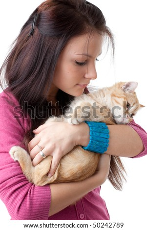 The happy young woman with a small amusing kitten on a white background.