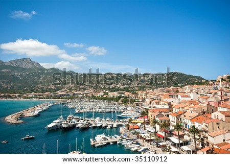 the harbor and the town of Calvi - stock photo