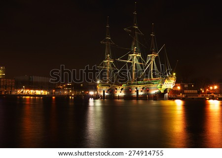 The harbor from Amsterdam in the Netherlands by night - stock photo