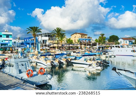 The harbor of Latchi village with the numerous cafes and bars at the central promenade, Cyprus. - stock photo