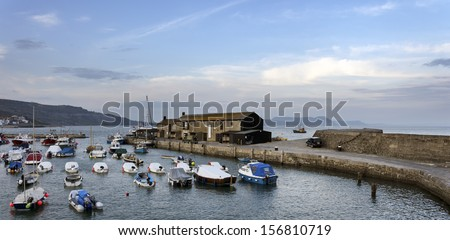 The harbour at Lyme Regis a small fishing port on the Jurassic Coast in Dorset - stock photo