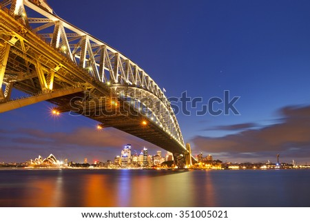 The Harbour Bridge and Central Business District of Sydney. Photographed at night. - stock photo