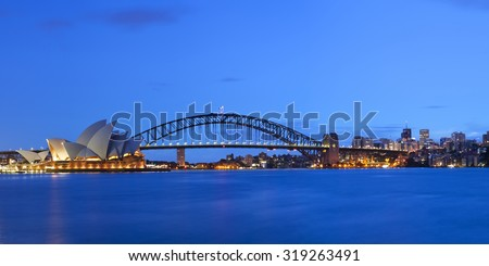 The Harbour Bridge, Sydney Opera House and Central Business District of Sydney. Photographed at dawn.