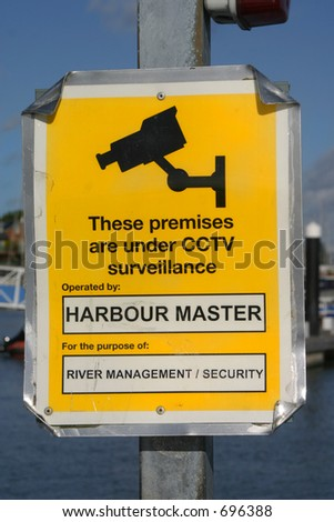 The harbour master is watching you - stock photo