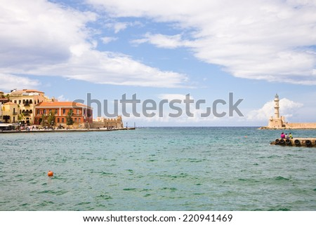The harbour of Chania in Crete with its venetian lighthouse, Greece - stock photo