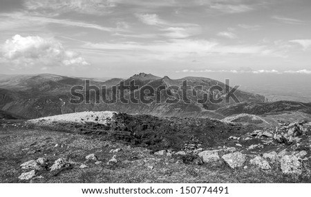 the hares gap a famous part of the mourne mountains with slieve bernagh in the background  - stock photo