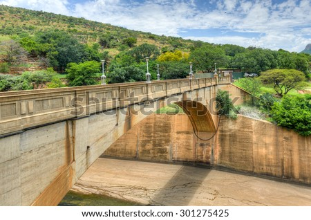 The Hartbeespoort Dam wall and tunnel in South Africa - stock photo