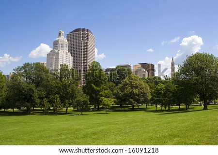 The Hartford Connecticut city skyline as seen from Bushnell Park. - stock photo
