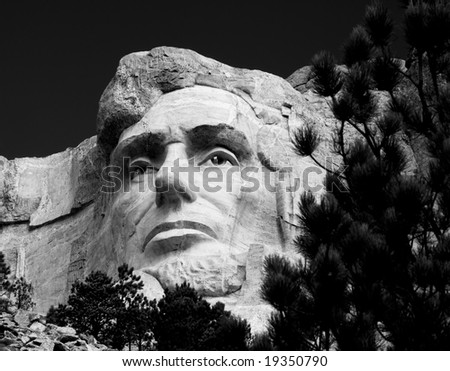 the head of Abraham Lincoln on Mount Rushmore National Memorial in black and white - stock photo