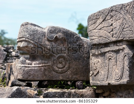 The head of the snake at the base of the pyramid in Chichen Itza, Mexico - stock photo