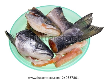 The heads and tails of  a fresh salmon fish  for food of a lovely cat. Isolated on white - stock photo