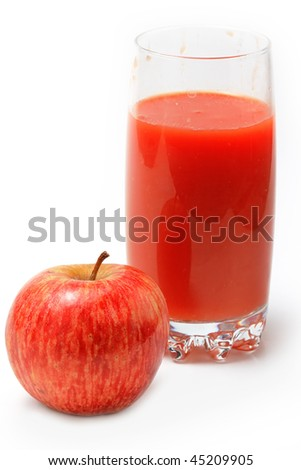 The healthy food. The red apple and vegetable juice