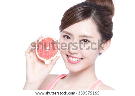 The healthy woman with grapefruit isolated on the white background, asian