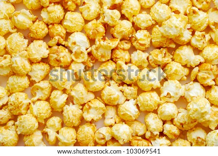 The heap of popcorn, top view - stock photo