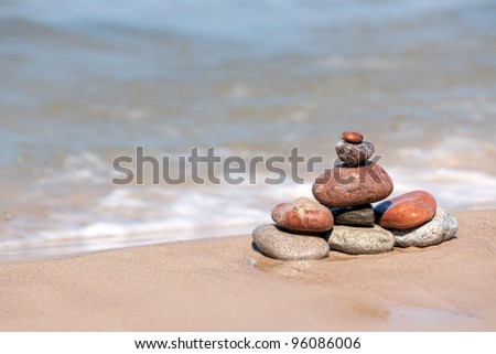The Heap of stones against the sea - stock photo