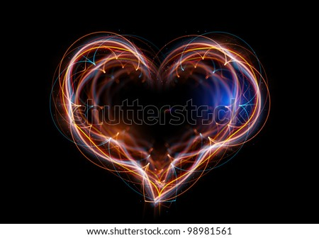 The heart made up of abstract energy. Shine multicolored lines with depth of field effect.