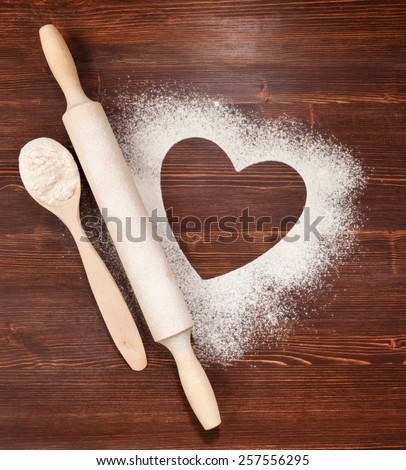 The heart of the flour on the table from the old boards - stock photo
