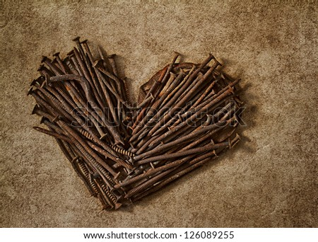 The heart of the old rusty nails - stock photo