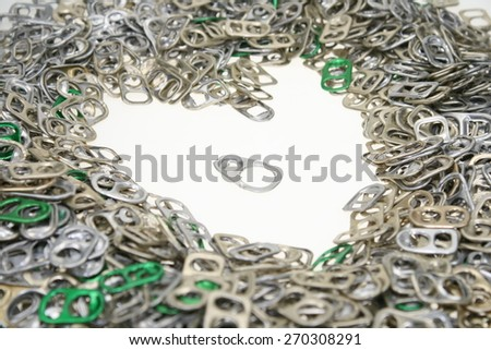 The heart of the ring-pulls on a white background. Chrome isolated heart. Symbol of love to technical progress. - stock photo