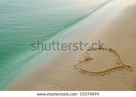 the heart on beach sand - stock photo