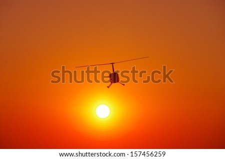 The helicopter from sunset - stock photo