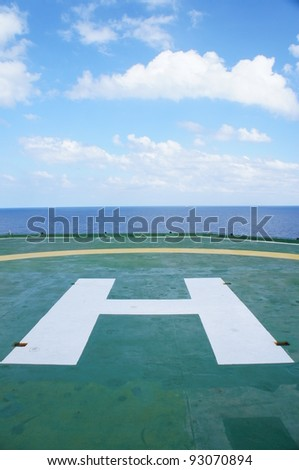 The Helideck of Oil and Gas Drilling Rig In The Middle of The Sea - stock photo