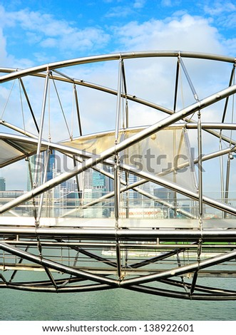 The Helix Bridge , previously known as the Double Helix Bridge , is a pedestrian bridge linking Marina Centre with Marina South in the Marina Bay area in Singapore - stock photo