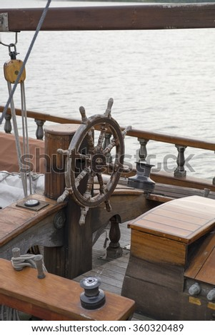 The helm of an historic sailing boat - stock photo