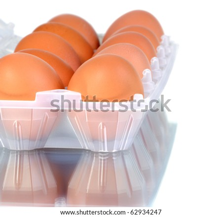 the hen's eggs in pack on white background - stock photo