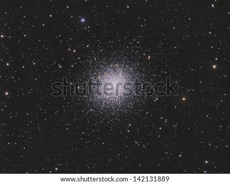 The Hercules Cluster - A globular cluster of about 300,000 stars about 22,000 light years away in the constellation Hercules - stock photo