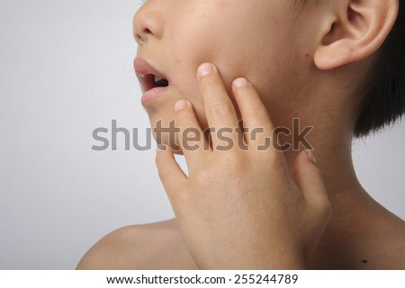 the herpes on young boy mouth feel pain - stock photo