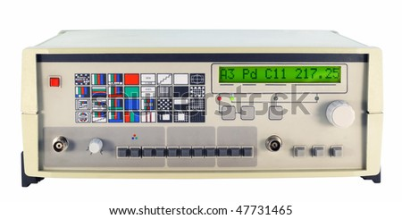 The hi-tech digital electronic device with the display for testing of TVs. Isolated on white with clipping path. Mass production. - stock photo