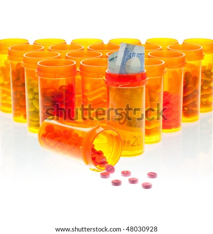 The High Cost of Health Care.  Pills and Euro Currency in Pill Bottles Isolated on White. - stock photo