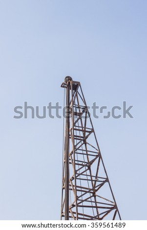 The high of crane on t he blue sky background - stock photo